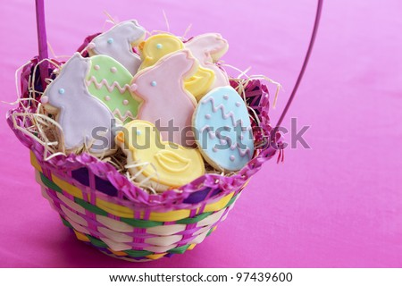 Mixed Easter cookies in basket with bunnies, lambs, eggs and chicks - stock photo