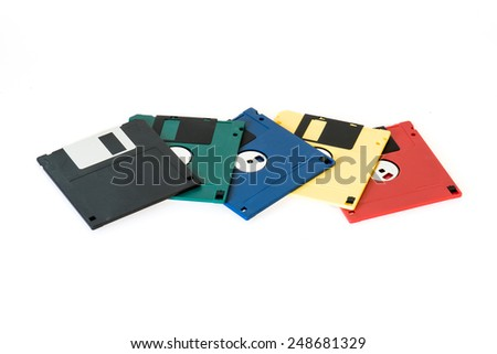 mixed floppy disk with dust on white background - stock photo