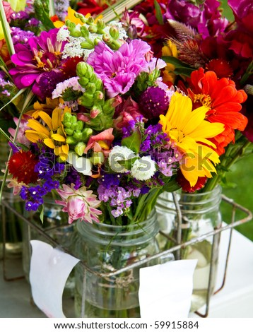 Mixed flower bouquets for sale at a local farmer's market - stock photo