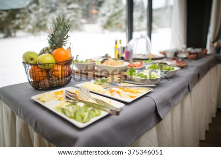 Mixed food on a plate, appetizer.Hotel breakfast board all you can eat buffet.Decorated arranged plates ready for service.Catering food wedding.Catering buffet food with colorful fruits and vegetables - stock photo