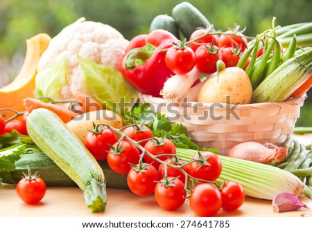 Mixed fresh vegetables in a basket on table