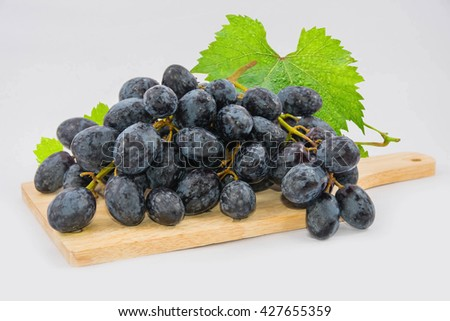 Mixed Fruit, Orange, apple, Bunch of red , Black and green  grapeson a white background, Closeup - stock photo