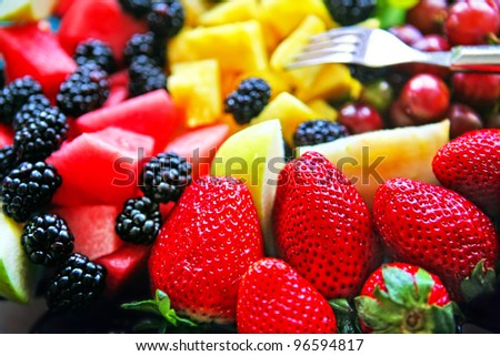 Mixed Fruit platter with fork - stock photo