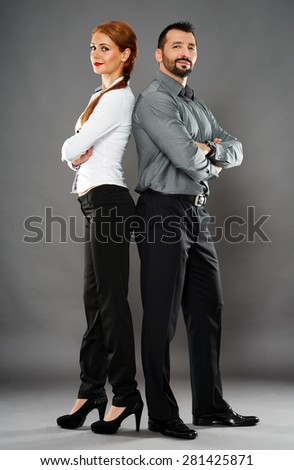 Mixed gender business team full length on gray background - stock photo
