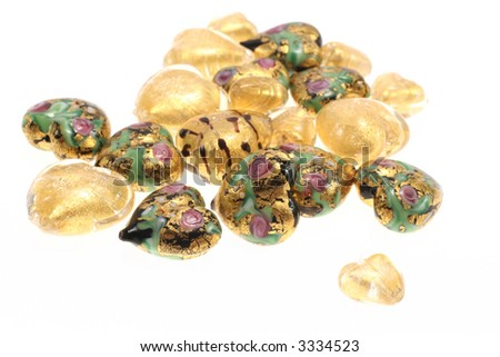 Mixed glass heart beads with gold foil.