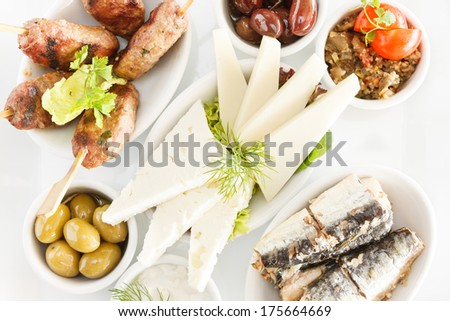 Mixed Greek Mezze for Ouzo, includes Meat balls, Graviera, olives, aubergine salad, sardines & tzaziki Served with Pita Bread - stock photo