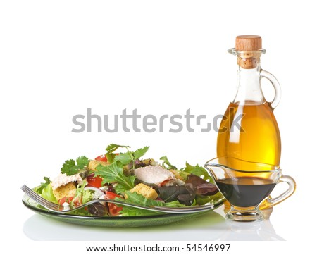 Mixed greens salad with olive oil and balsamic vinegar on the side - stock photo