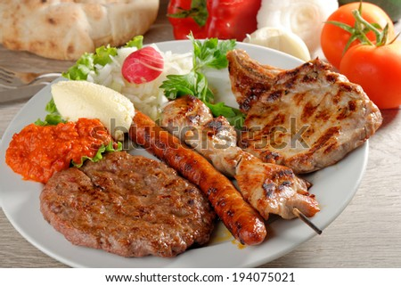 Mixed grill on a plate, Balkan food (selective focus)  - stock photo