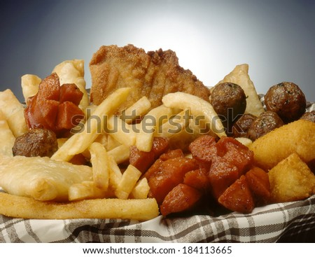 Mixed grilled and fried meat platter  - stock photo