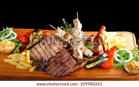 Mixed grilled meat platter  - stock photo