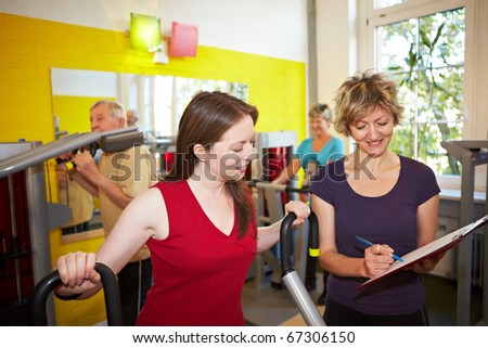 Mixed group doing circuit training in a gym - stock photo
