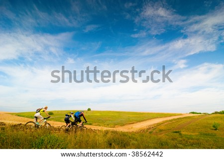 mixed group of cyclists biking - stock photo