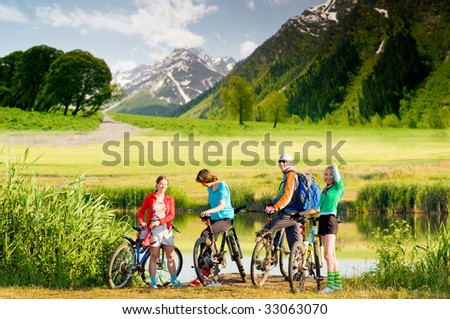 mixed group of cyclists  outdoors - stock photo