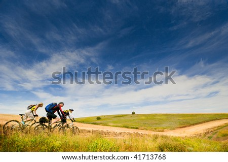 mixed group of cyclists relax biking outdoors - stock photo
