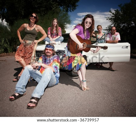 Mixed group of happy modern adult hippies