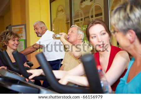 Mixed group taking  class in a gym - stock photo