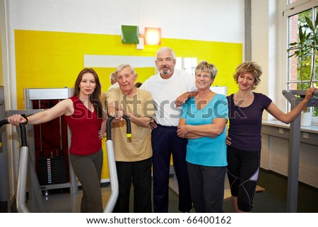 Mixed group with elderly people in a gym - stock photo