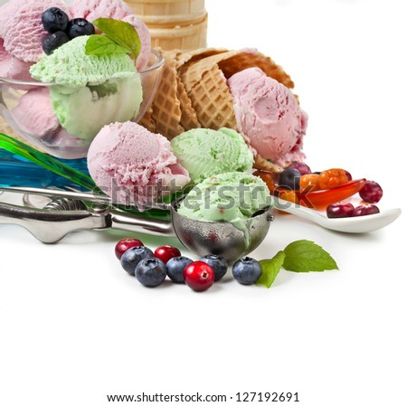 Mixed ice cream with fresh berries isolated on white - stock photo