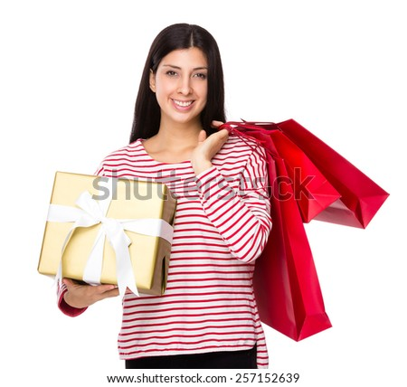 Mixed Indian woman hold with shopping bag and a big gift box
