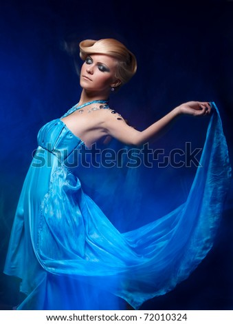 Mixed light fashion portrait of young attractive woman - stock photo