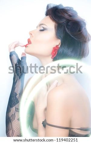 Mixed light sensual portrait - stock photo