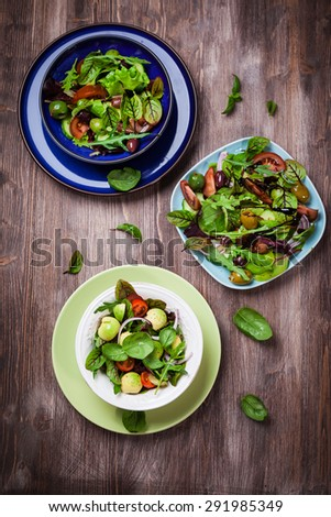 Mixed low calorie salads with olives and fresh avocado - stock photo
