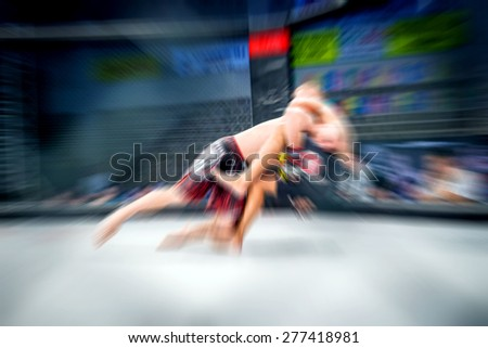 Mixed martial artist in action of fight. Zoom blur. - stock photo