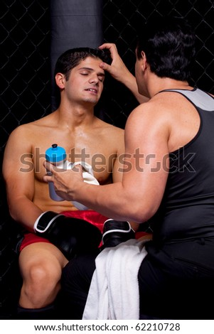 Mixed martial artist with corner man - stock photo