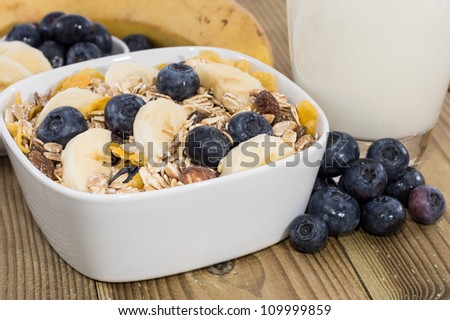 Mixed Muesli with Nuts and Fruits on wooden background - stock photo