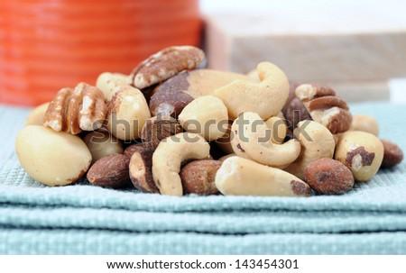 mixed nut: pecan, almond, peanut, brazil nut, cashew, hazelnut - stock photo