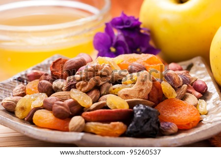 mixed nuts and dry fruits on a plate - stock photo