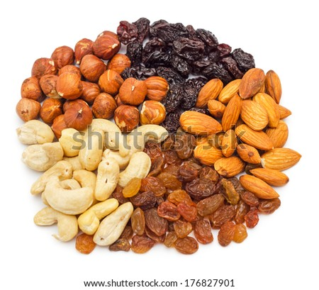 Mixed nuts and dry fruits pile isolated on white background - stock photo