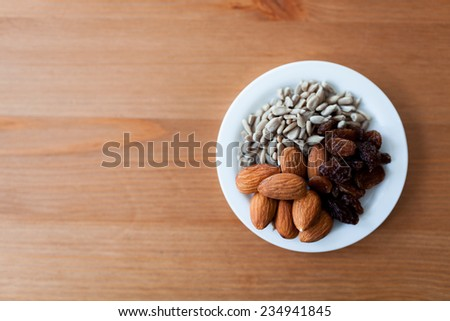 mixed nuts, bread and a cup of coffee - stock photo