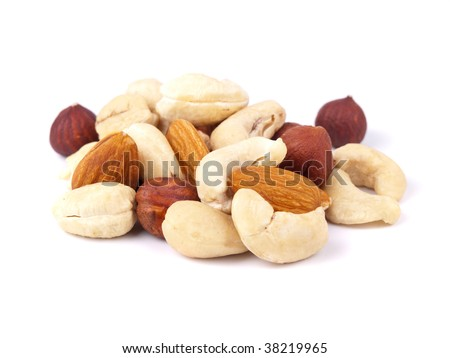 Mixed nuts closeup view on white background - stock photo