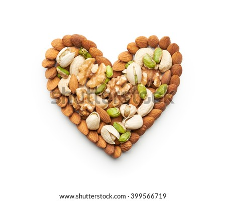 Mixed nuts forming a heart-shape isolated on white - stock photo