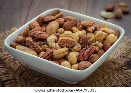 Mixed nuts in bowl - stock photo
