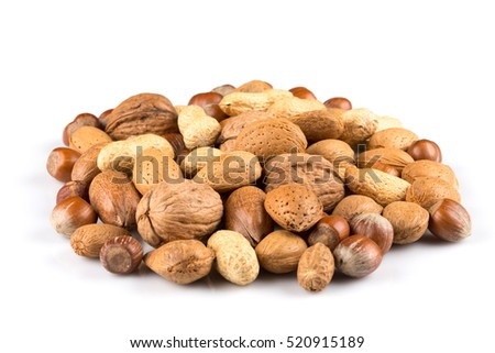 Mixed nuts in shells on a white background