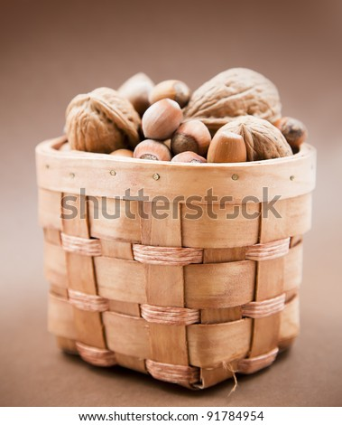 Mixed nuts in the basket - stock photo