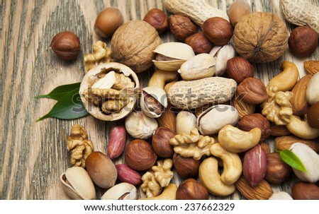 Mixed nuts on a wooden background  - stock photo