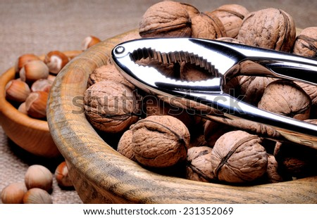 Mixed nuts with nut cracker - stock photo