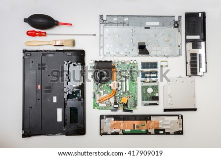 Mixed part in laptop computer,Repair computer concept,Top view - stock photo