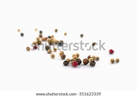 Mixed pepper balls on white background - stock photo
