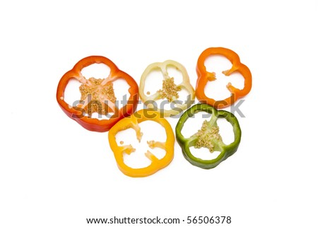 Mixed pieces of different colored paprika isolated on white - stock photo