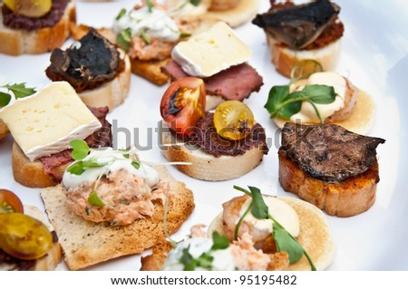 Mixed plate of canapes - stock photo