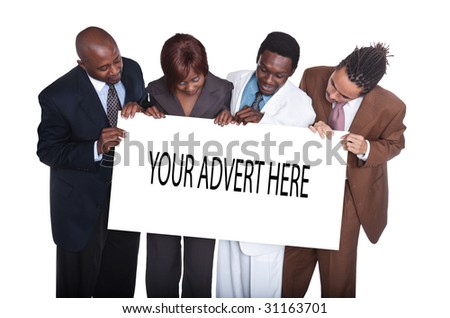 mixed race and gender group of young business people, holding advert - stock photo