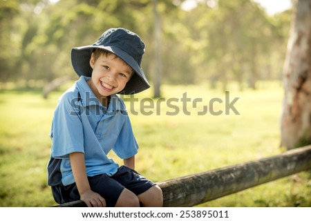Mixed race Asian Caucasian boy cheerfully starts his first day of school - stock photo