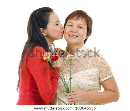 Mixed race asian daughter giving a kiss to her mum isolated on white - stock photo