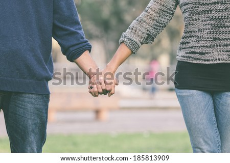 Mixed-Race Couple Holding Hands - stock photo