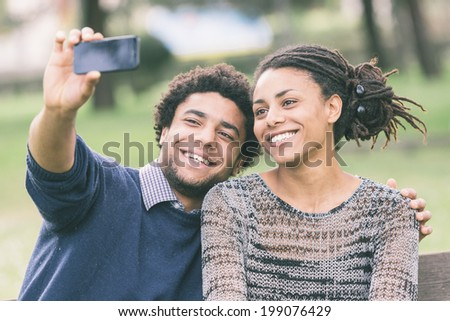 Mixed-Race Couple Taking Selfie - stock photo