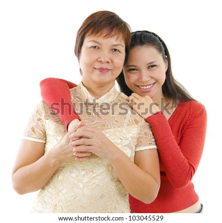 Mixed race daughter hugging her mother isolated on white background - stock photo